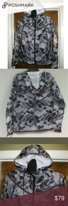 NIKE Floral Running Light Windbreaker Jacket NWT NIKE Running Light jacket. Floral mesh pattern in black, grey and white. Windbreaker. Water resistant. Reflective elements for visibility in low light. Stretch cuffs for secure fit. Front pockets. Faux mesh pattern all over.  NWT $150. Please note that only part of the tag is intact. See photo. 100% new and authentic. Size small.  Tags Adidas jacket Sweatshirt Hoodie Urban Outfitters American Apparel ASOS Lululemon jacket Nike full zip zipper…