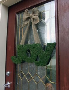 Moss JOY with rustic burlap bow. Holiday Wreaths, Holiday Crafts, Holiday Fun, Christmas Time, Christmas Decorations, Holiday Decorating, Christmas Ideas, Christmas Door, Holiday Ideas