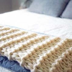 This arm knit blanket is chunky and over-sized and fabulous in every way! This blanket is done in garter stitch. In arm knitting, this means you are knitting one direction and purling the other dir...