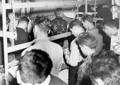 Catholic Mass on board an LCI enroute to Normandy invasion beaches.