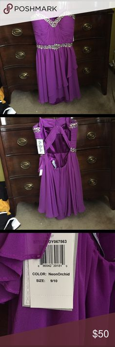 Brand new purple strapless formal dress NWT NEVER WORN. Shorter. Comes above the knees Dresses Strapless