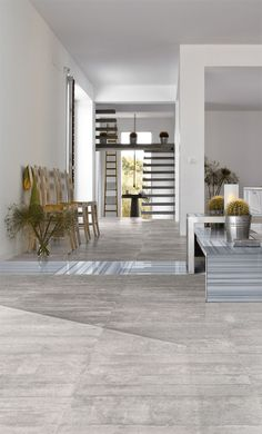 Porcelain tile with concrete pattern and porcelain tile with vein-cut marble pattern (inset). Photo courtesy of Specialty Tile Products