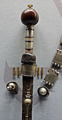 Weapons and personal items, primarily 3rd century AD, thought to be the equipment of defeated armies. Many of the items have been ritually 'killed' before being sacrificed. Ivory pommel and guard, silver gilt hilt, silver scabbard and baldric fittings. .Moesgård Museum... Matt Bunker - Wulfheodenas