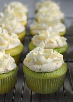 Pistachio cupcakes with vanilla butter cream frosting and white chocolate shavings.