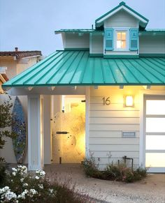 Turquoise roof, shutters with anchors, wave glass entry door and surfboard shower. Wow! Take the tour here: http://beachblissliving.com/turquoise-beach-cottage/ Beach house | coastal home #beachhouse #coastalcottage #beachcottage