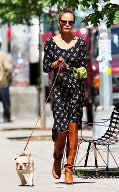 Chrissy Teigan took her pup for a walk in style! Check her out in a floral dress, knee-high boots and sleek cat-eye sunnies!