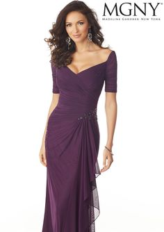 Morilee | Madeline Gardner, Stretch Mesh Evening Gown with Draping and Beading Style 71820 | Stretch Mesh Evening Gown with an Asymmetrically Draped V-Neck Bodice. A Cascading Side Ruffle and Beaded Detail at the Waist Complete the Look. Colors Available: Black, Eggplant