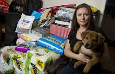 Hull's Haven Border Collie Rescue volunteer Jill Britton with Chubbs and remaining supplies at her home Saturday afternoon. Britton said 44 boxes of dog food and supplies, bound for a northern dog rescue operation, were stolen from behind her home on Tuesday evening. Read the story for details. Winnipeg, Canada.