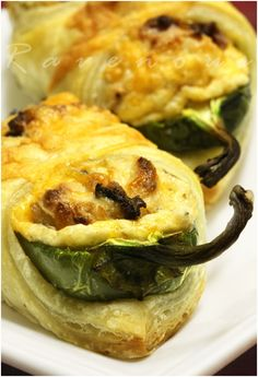With cream cheese, shredded cheese, roasted garlic, and bacon bits. Wrap in puff pastry. 31 Fearless Ways To Stuff A Jalapeño Chile Think Food, I Love Food, Food For Thought, Good Food, Yummy Food, Mexican Food Recipes, Great Recipes, Favorite Recipes, Jai Faim