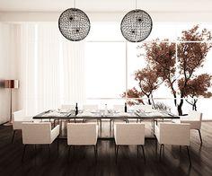 Salle à manger lumineuse avec grande table à manger noire et dix chaises blanches