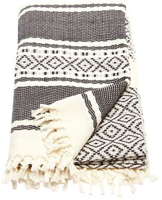 Ixchel Beach Blanket by Wax + Cruz. 100% cotton beach blanket handwoven by master-artisans in Mexico. This unique piece does perfect double duty as a wrap, towel, or home textile. - See more at: https://www.decorist.com/finds/61595/bw-ixchel-beach-blanket/