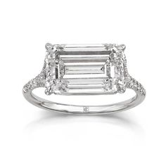 Updated emerald cut diamond engagement ring