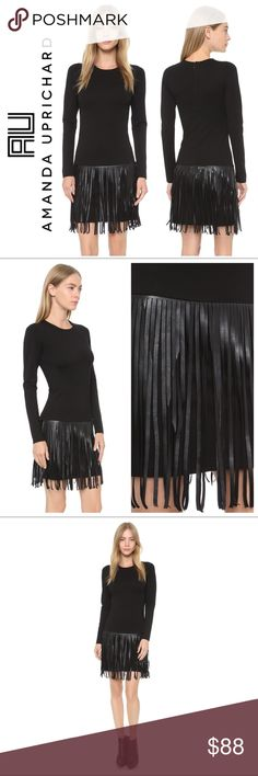 """Amanda Uprichard Colt Fringe Ponte Dress This Amanda Uprichard dress is trimmed in faux-leather fringe, giving the simple silhouette a bohemian twist. Hidden back zip. Long sleeves. Unlined. Fabric: Ponte jersey. Shell: 63% rayon/32% nylon/5% spandex. Trim: 100% polyester. Size XS. Measurements: Chest 14""""-17"""" Total Length: 33.5"""" Fringe Length 14"""". Excellent condition with no apparent signs of wear or flaws. Amanda Uprichard Dresses Mini"""