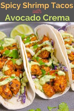 These Spicy Shrimp Tacos are marinated in delicious spices and sit on top of a homemade slaw with an avocado crema that makes these so addicting! #shrimptacos #taco #shrimp #seafood #seafoodtacos #mexican #tacotuesday #avocadocrema #spicyshrimp #tacorecipe #avocadosauce Fish Recipes, Meat Recipes, Seafood Recipes, Mexican Food Recipes, Food Processor Recipes, Dinner Recipes, Cooking Recipes, Healthy Recipes, Drink Recipes