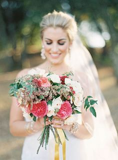 Colorful Bridal Bouquet with Roses, Greenery, and Berries | Brides.com