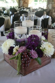 purple wedding centerpieces with grapes / http://www.deerpearlflowers.com/unique-wedding-centerpiece-ideas/6/