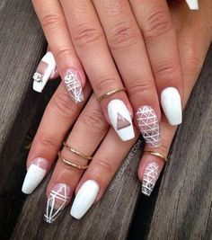 Geometric designs will never go wrong especially when you combine it with simpler designs, like plain white nails or particular spots left unpainted for the design.