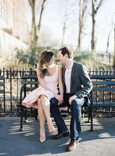 couple sitting on NYC park bench, girl in pink Halston Heritage dress, engagement photo ideas http://itgirlweddings.com/stylish-nyc-engagement-shoot/