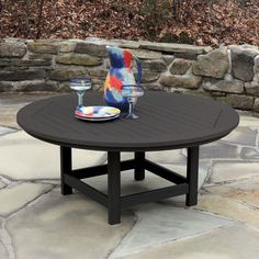 The weather-loving Highwood Hamilton Recycled Plastic Round Adirondack Table is scaled to accommodate four people in style. Perfect for any patio.