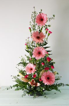 symmetrical front facing arrangement with Gerbera Daisies, mini carnations, and spiral eucalyptus. Altar Flowers, Church Flowers, Funeral Flowers, Wedding Flowers, Orchid Flowers, Easter Flower Arrangements, Beautiful Flower Arrangements, Beautiful Flowers, Floral Arrangements For Funeral