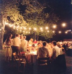 Vineyard-esque wedding setting complete with oversized strings of light bulbs. You can feel the warmth ooze from this picture