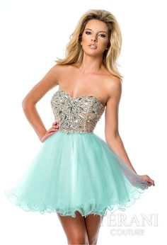 Tulle sweetheart party dress featuring a crystal encrusted bodice, natural waistline and flared mesh skirt.