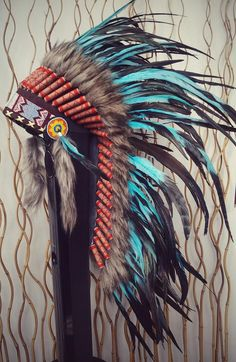 Medium Turquoise Feather Headdress (36 inch long )  Handmade Native Feather Headdress, made with the best materials.  The headdress has 60 sets of feathers and every set has 3 feathers on it with Turquoise and shining natural green color.  The size headdress are:  width: 38,2 inches  feathers high 16,1 inches  full headdress high 36 inch  Elegant model.  In Stock, Ready to Send!!  ** NOW: UPS FAST SHIPPING: 3-4 WORKING DAYS **