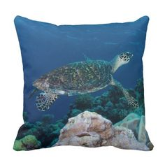 Throw pillow featuring a Hawksbill Sea Turtle swimming in the crystal blue waters of the Coral Sea on Australia's Great Barrier Reef.