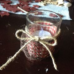My sister Ashley is making decorations our rustic reception. A simple votive jar dressed up with lace and gingham ribbon and a twine bow!  Love it!
