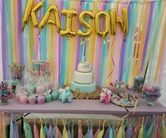 Unicorn birthday party candy table