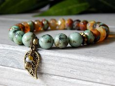 About the Bracelet This nature inspired bracelet features African turquoise which is know to help one connect with the earth. Bracelet Details: This nature bracelet is made with: ♥ 8mm African Turquoi