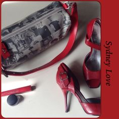 """SYDNEY LOVE NEWSPRINT BARREL BAG WITH SHW Newsprint style statement bag by Sydney Love in black & white with crisp red adjustable strap & accents!  Inside is lined in red & white plaid pattern to add whimsy to the bag!  Large enough to hold plenty of your essentials for a day or night out!! Images from the 70's to 80's are the theme & include a very young Boy George, Christie Brinkley, Andy Warhol & Marlon Brando (The Contender). The bags theme is """" Oh Boy..George is back in fashion"""". Very…"""