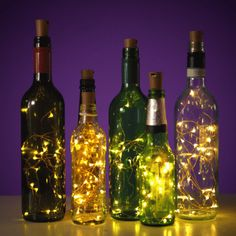 Bottle Lighes I've used three of them so far in wine bottles🍾 I'm going to use them down a walkway in my backyard for a small family wedding💖💖 They would be romantic for low light dining or on a patio at night. Empty Glass Bottles, Glass Bottle Crafts, Painted Wine Bottles, Lighted Wine Bottles, Diy Bottle, Bottle Lights, Bottle Art, Wine Bottle Lighting, Bottle Lamps