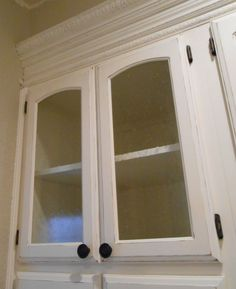 I found a great article here about the step-by-step process of converting solid cabinet doors to glass. We lucked out and our cabinet doors were panel doors. In the long run, this saved us some sub...