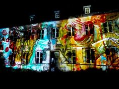 Program | Ghent Lightfestival 2015 | IYL2015 AIL2015. 13. Claudia Reh - Echtzeitlicht Zandberg  An imaginary garden in the heart of the city blooms on the white walls of the Zandberg. The radiant gardens symbolise a colourful society that is nourished and protected.