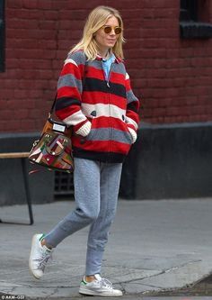 Casual: Sienna, 34, cut a casual figure in grey joggers paired with a thick striped zipper...