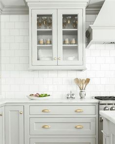 """scoutandnimble on Instagram: """"The most beautiful soft gray cabinetry looks gorgeous against the white backsplash. And then there's the hardware  Design by @heidipiron"""""""