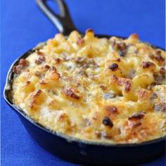 Breakfast mac & cheese - made with sweet breakfast sausage, onions, peppers, eggs and biscuit pieces.