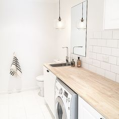 Find yourself spending a lot of time in the laundry? Three Bird Renovations recommend jazzing up the space and adding a pendant light. This reno features our Clear Laurent Pendant Light vintagelight - Minimal Interior Design Laundry Bathroom Combo, Small Laundry Rooms, Small Bathroom, Laundry Tubs, Bathroom Closet, Basement Laundry, Downstairs Bathroom, Laundry Cupboard, Tiny Bathrooms