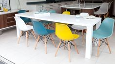 White Gloss Extending Dining Set and Eames Chairs (£399) - extends from 1200mm to 2400mm - comfortably seats 10 people when fully extended or 4-6 when not extended.
