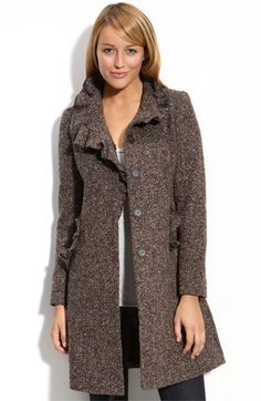 Love the coat, especially the ruffle on the collar. Don't love the ruffle on the pockets or the color. Would like bigger buttons. Also, no hood.