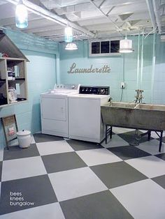 I love the fresh paint on the cinderblock walls and bar wood ceiling.  What a spunky laundry room.  and that Launderette font is great.