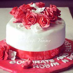 Cake Decor Rosettes - A Liquor Cake with White and Red Fondant, White and Red Rose Rosettes Decor | All Things Yummy #cake #flowers #roses #gumpaste #edibleflowers #hydrangae #redandwhite #redroses #marriage #bride #groom #pretty #allthingsyummy