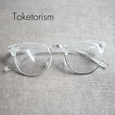 Toketorism Personalized designer fashion transparent frame glasses for man and w. - Toketorism Personalized designer fashion transparent frame glasses for man and woman. Glasses Frames Trendy, Fake Glasses, Glasses Man, Transparent Glasses Frames, Cheap Eyeglasses, Eyeglasses For Women, Lunette Style, Round Lens Sunglasses, Fashion Eye Glasses
