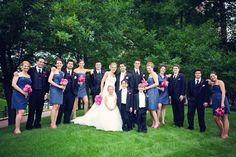 Caspian blue J. Crew bridesmaid dresses with hot pink flowers & shoes