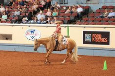 For the second year in a row, Deanna Green wins the youth world championship in western riding with Blazinmytroublesaway. | #AQHYAWorld #GetThatGlobe