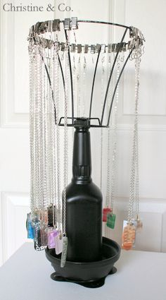 What do you get when you have a scotch bottle and an old lampshade? #visualmerchandising #jewelrydisplay #displayideas