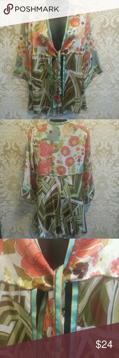 CAbi Tie Front Bell Sleeve Kimono Tunic Jacket Beautiful Floral Print -  Empire Waist -  3/4 Bell Sleeves -  Good pre-owned condition -  Care/size tag missing -  Laying flat armpit to armpit 17in -  Size Small CAbi Tops Tunics