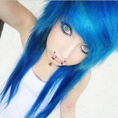 deep blue hair, sage green eyes, and canine bites piercing  posted by dropdeadkidz on instagram