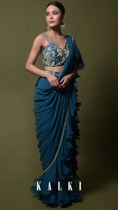 Teal ready pleated saree in georgette with ruffle frill and hand embroidered blouse online - kalki fashion Saree Designs Party Wear, Lehenga Designs, Saree Blouse Designs, Saree Wearing Styles, Saree Styles, Trendy Sarees, Stylish Sarees, Indian Fashion Designers, Indian Designer Outfits